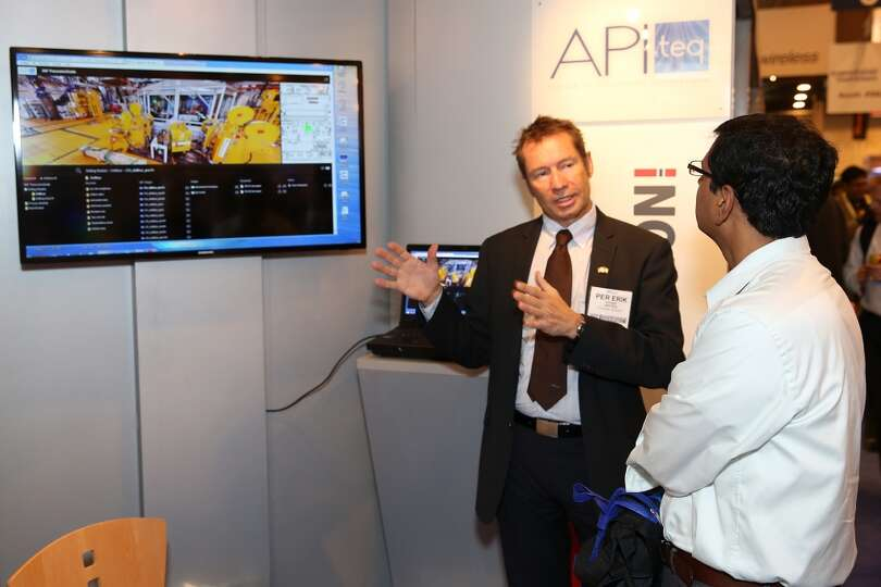 An customer talks to Per Erik of API teq on day three of OTC on May 7, 2014 inside the NRG Center in