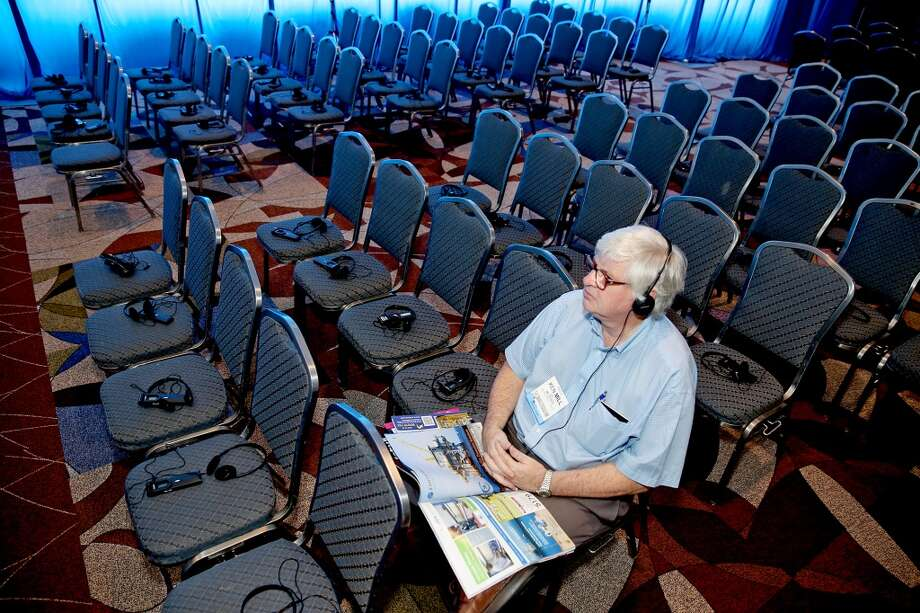 Ken Mill with IMC Brasil listens to the Mooring Systems Design and Remediation lecture on head phones on day three of OTC on May 7, 2014 inside the NRG Center in Houston, TX. (Photo: Thomas B. Shea/For the Chronicle) Photo: For The Chronicle