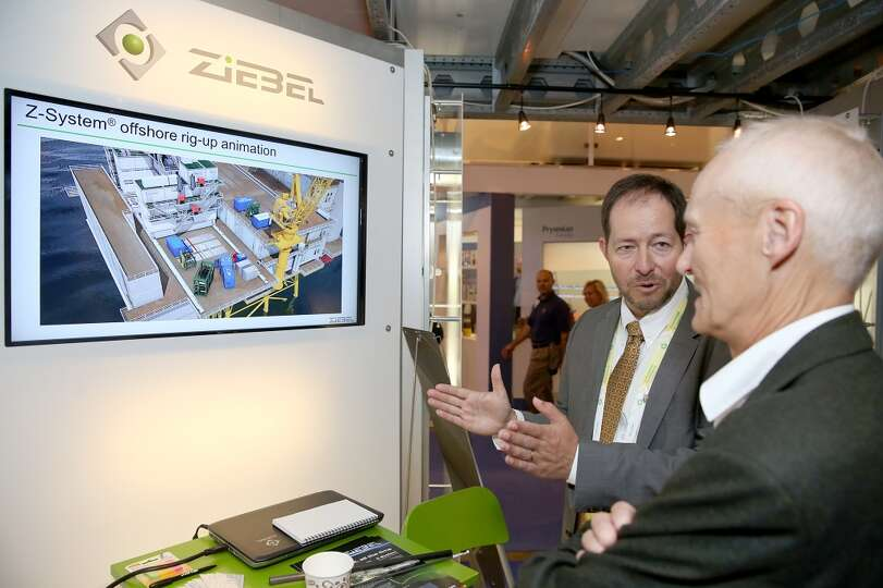 A customer talks to a Ziebel employee at Innovation Park on day three of OTC on May 7, 2014 inside t