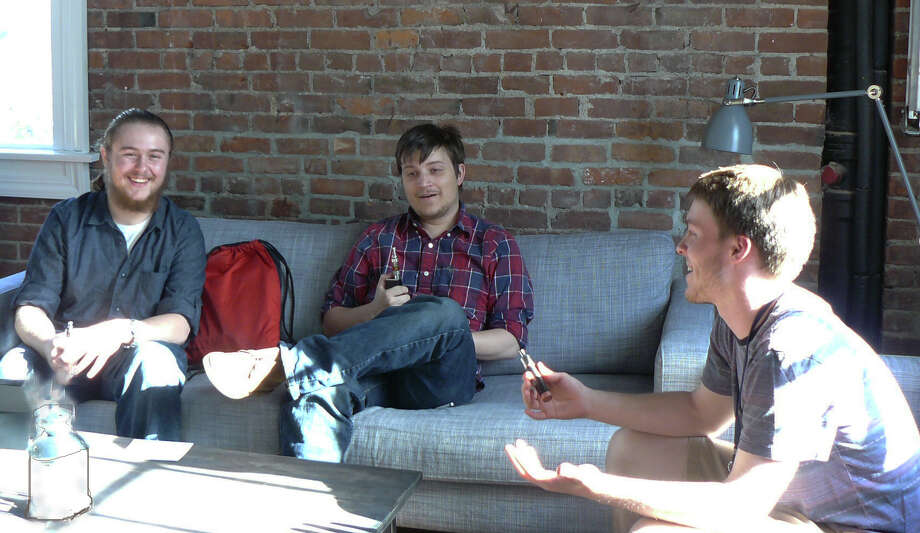 Customers at the newly-opened Sovereign Vapors Loft, all former smokers, recently enjoyed 'vaping' with electronic cigarettes in a comfortable enviornment. From left: Josh Gelman, Bryn Hagley, and Avery Salveson. Photo: Staff Photo/Gretchen Webster / Fairfield Citizen