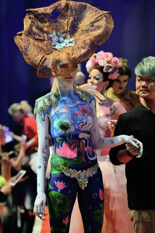 A participant accompany his model for the rating of the jury during the 'Body Painting' contest of the OMC Hairworld World Cup on May 4, 2014 in Frankfurt am Main,  Germany. Photo: Thomas Lohnes, Getty Images / 2014 Getty Images