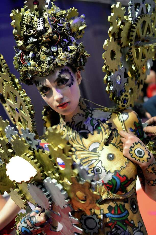 A model poses on the catwalk after the contest 'Body Painting' of the OMC Hairworld World Cup on May 4, 2014 in Frankfurt am Main, Germany. Photo: Thomas Lohnes, Getty Images / 2014 Getty Images