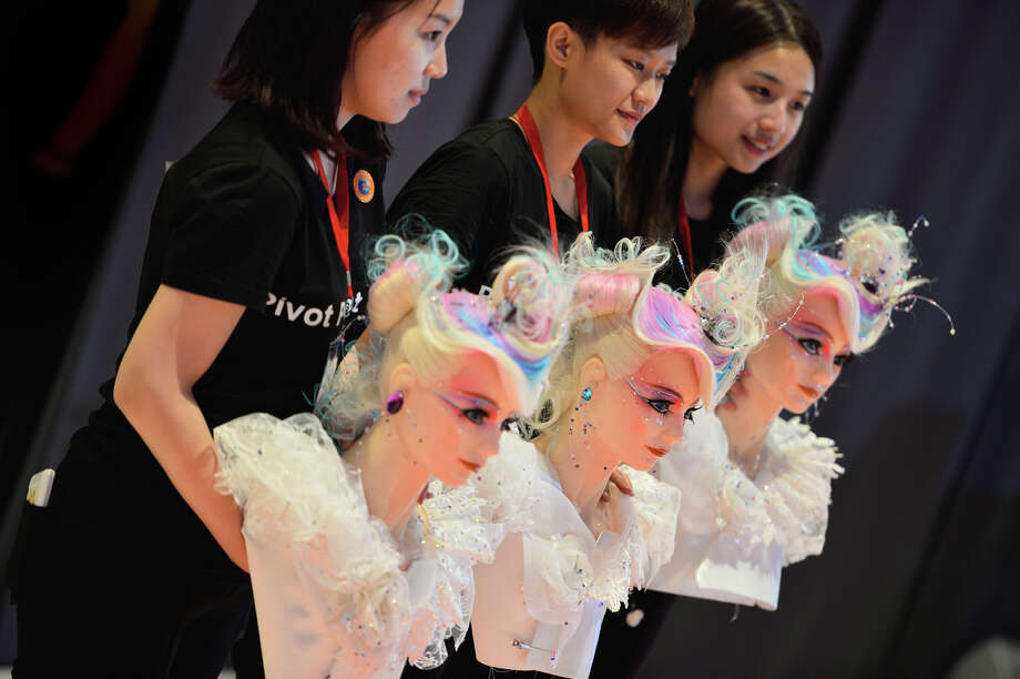 Hairdresser from Taiwan pose with their dolls at the OMC Hairworld World Cup on May 4, 2014 in Frankfurt am Main, Germany. Photo: Thomas Lohnes, Getty Images / 2014 Getty Images