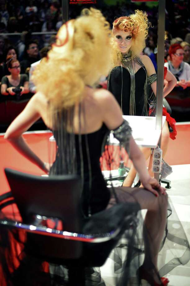 "A model styled by a participant waits to be judged by the jury during the contest ""Day style"" of the OMC Hairworld World Cup on May 4, 2014 in Frankfurt am Main, Germany. Photo: Thomas Lohnes, Getty Images / 2014 Getty Images"