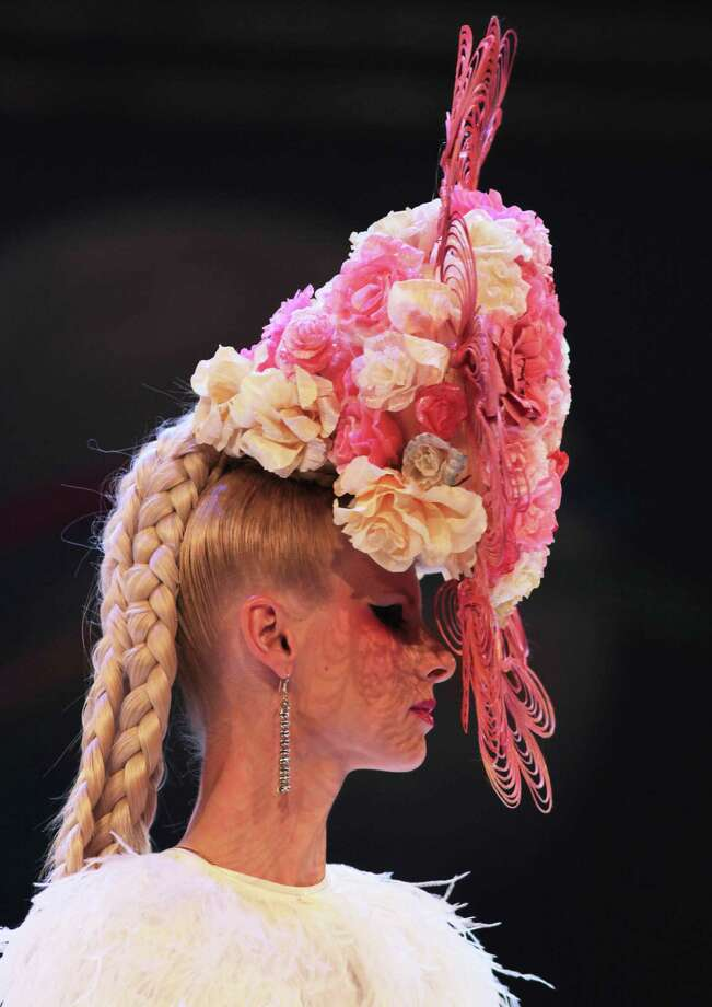 Models walk on the podium to present the OMC Prestige Club World President Irina Baranova's show of hairstyle during the OMC Hairworld World Cup contest on May 5, 2014 in Frankfurt am Main, Germany. Photo: Anadolu Agency, Getty Images / 2014 Anadolu Agency