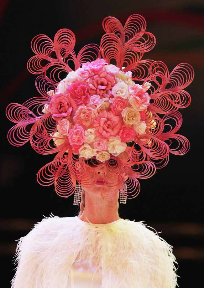 Models walk on the podium during the OMC Hairworld World Cup contest on May 5, 2014 in Frankfurt am Main, Germany. Photo: Anadolu Agency, Getty Images / 2014 Anadolu Agency