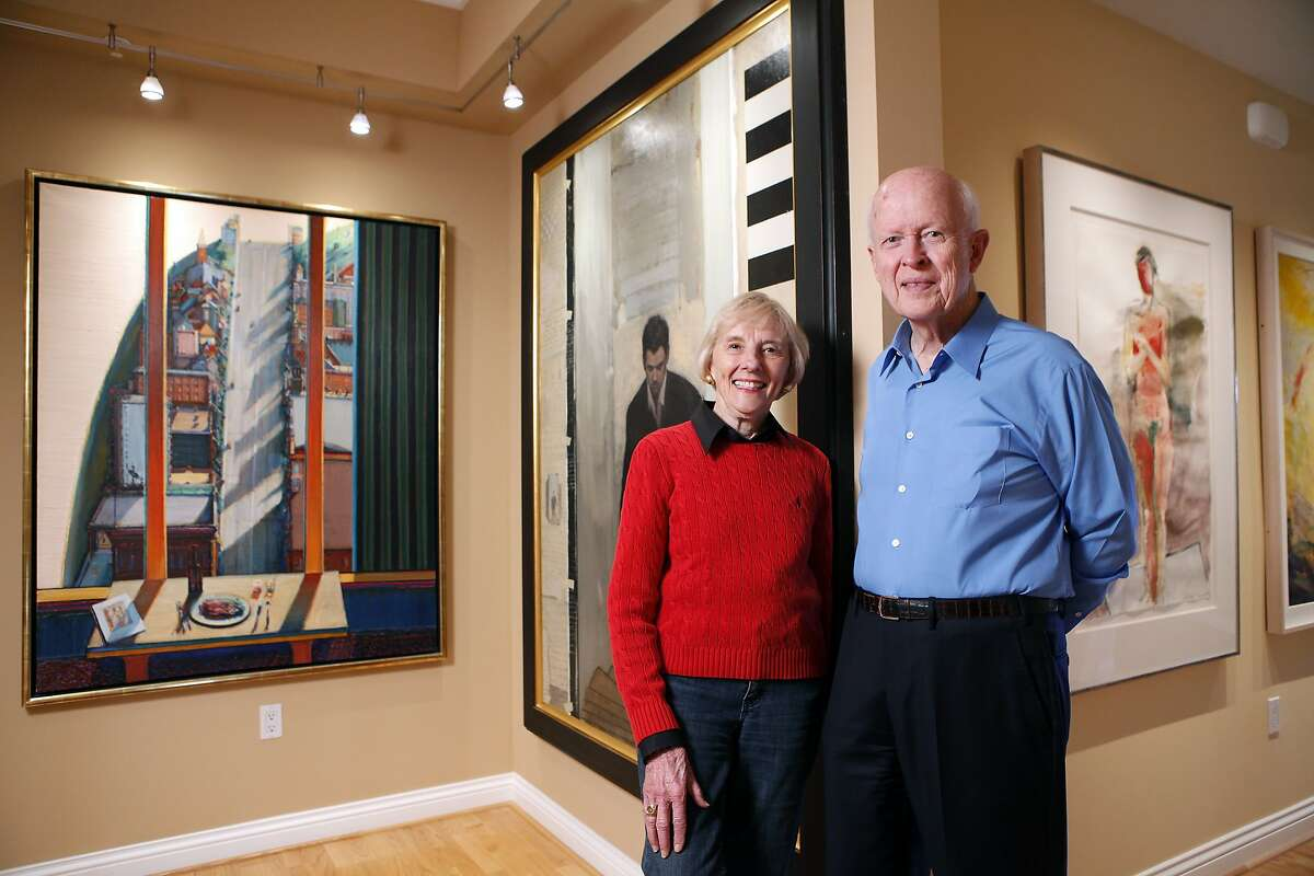 Burt and Deedee McMurty pose for a portrait with paintings by(L-R) Wayne Theibaud, Stephen Conway and Manuel Neri at their home in Stanford, CA, Wednesday April 24, 2014. Burt and Deedee McMurtry gave $30 million to Stanford for naming rights to the McMurtry Art Building, now under construction for the departments of Art and Art History at Stanford University where Burt studied electrical engineering.