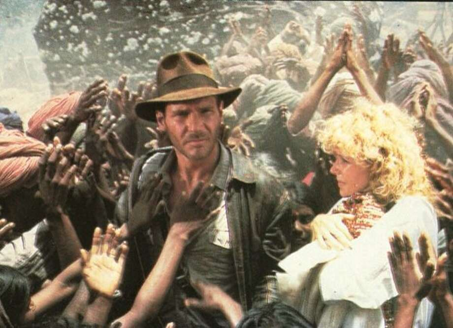 "Harrison Ford and Kate Capshaw in ""Indiana Jones and the Temple of Doom"" 1984 Photo: Paramount 1984"