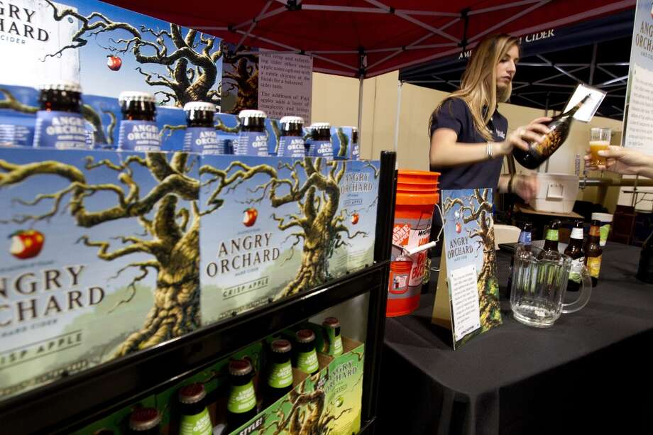 The Angry Orchard Hard Cider booth during the Faust Distributing retailer trade show Thursday, April 24, 2014, in Houston.PHOTOS: The weirdest and wildest craft beer names you'll find ... Photo: Johnny Hanson, Houston Chronicle