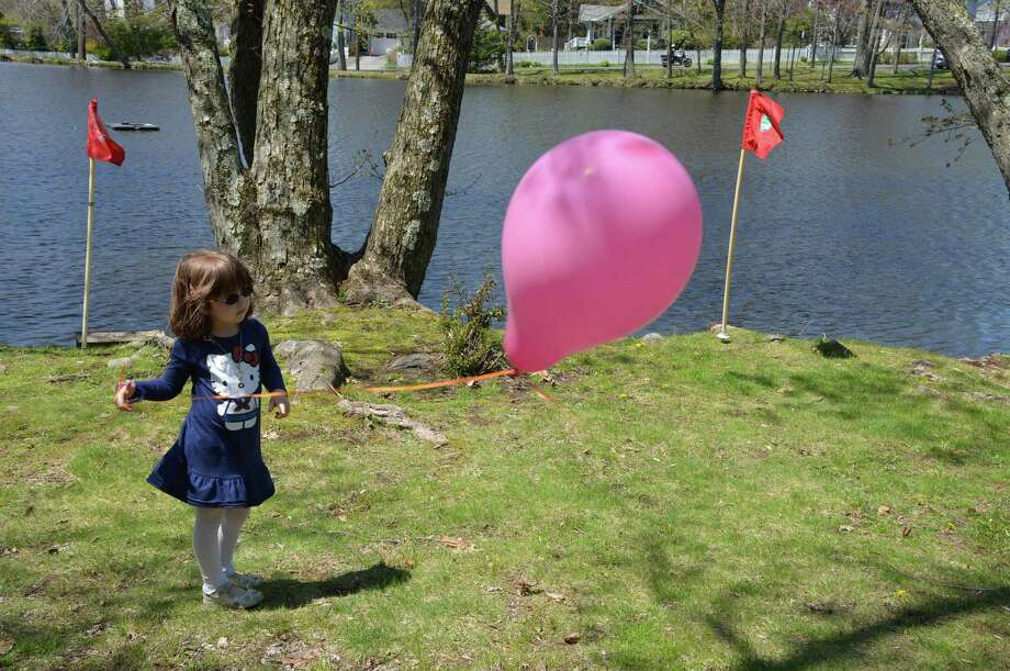 Fiona Collins, 5, of Darien, tests the wind Saturday, May 3, at the 22nd annual Tilley Pond Model Boat Regatta, which was sponsored by the Darien Youth Commission. Jarret Liotta / For the Darien News Photo: Contributed Photo, Contributed / Darien News Contributed