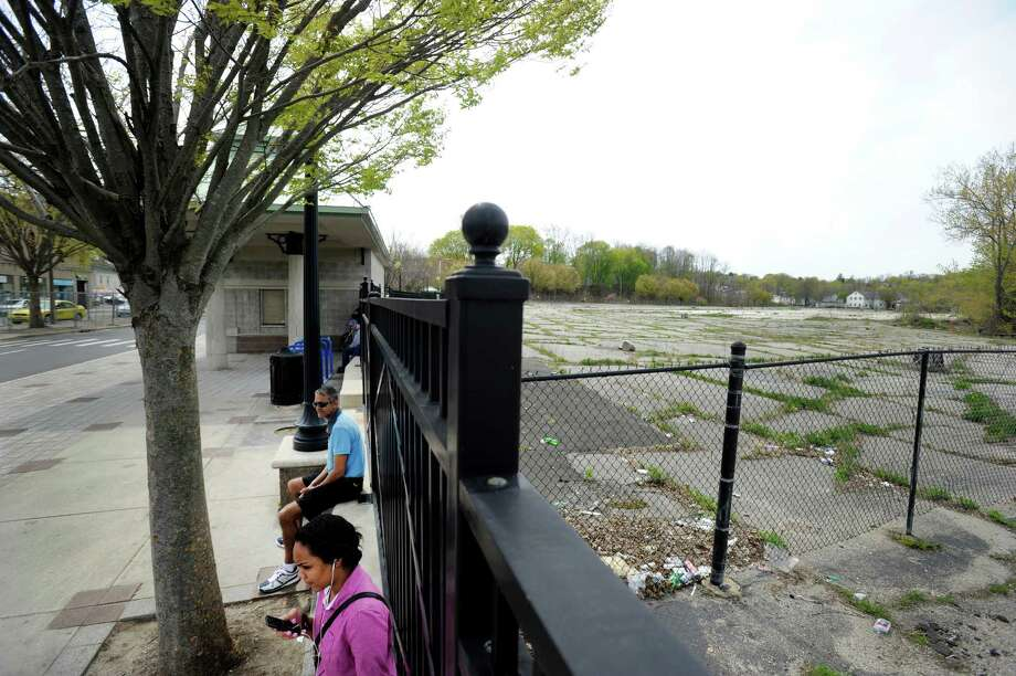 Many officials hope that Kennedy Place, a $70 million luxury housing complex planned for a long vacant lot in Danbury's downtown, will become a driver for revitalization in the city's center. This view is from the bus station on Kennedy Avenue Wednesday, may 7, 2014. Photo: Carol Kaliff / The News-Times
