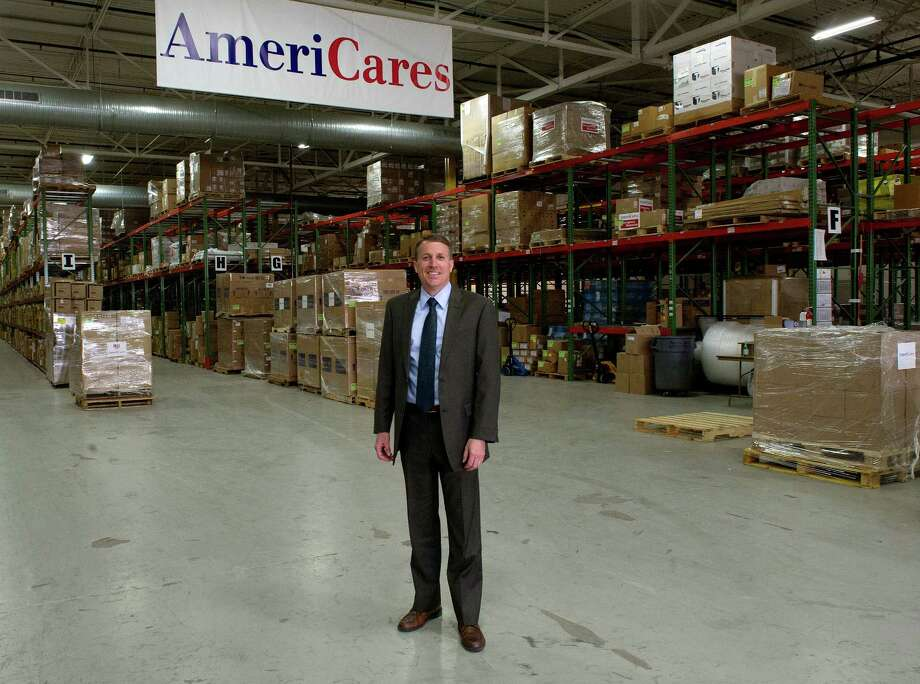 AmeriCares CEO Michael Nyenhuis poses for a photo in the organization's Stamford, Conn., office on Wednesday, May 7, 2014. Photo: Lindsay Perry / Stamford Advocate