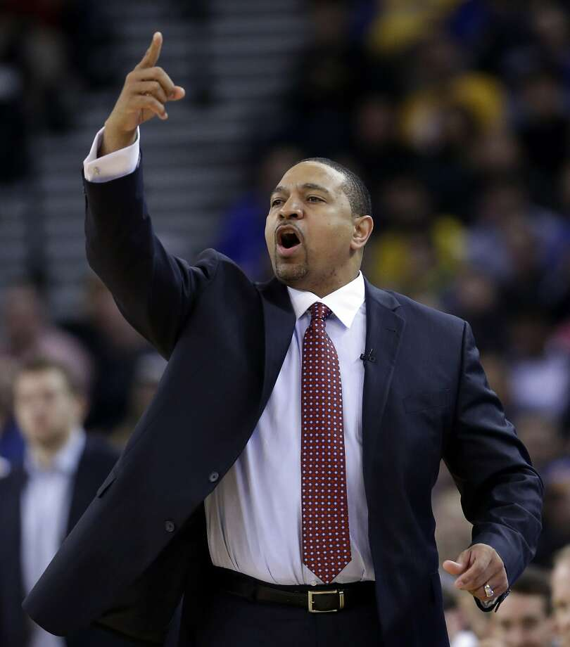 FILE - In this Thursday, Feb. 6, 2014, Golden State Warriors head coach Mark Jackson instructs his team during the first half of an NBA basketball game against the Chicago Bulls in Oakland, Calif. The Warriors fired Jackson on Tuesday, May 6, 2014. (AP Photo/Marcio Jose Sanchez, File) Photo: Marcio Jose Sanchez, Associated Press