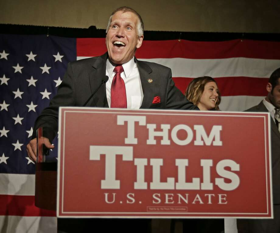 Thom Tillis speaks to supporters at a election night rally in Charlotte, N.C., after winning the Republican nomination for the U.S. Senate Tuesday, May 6, 2014.   Tillis, the Republican establishment's favored son in North Carolina, won the state's Senate nomination by running as a proud conservative who's not terribly different from his tea party and Christian-right opponents.  (AP Photo/Chuck Burton) Photo: Chuck Burton, Associated Press