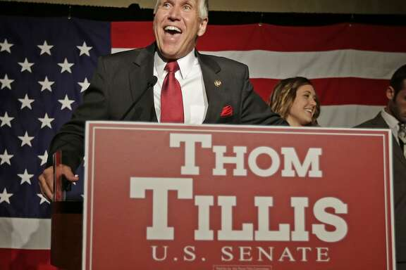 Thom Tillis speaks to supporters at a election night rally in Charlotte, N.C., after winning the Republican nomination for the U.S. Senate Tuesday, May 6, 2014.   Tillis, the Republican establishment's favored son in North Carolina, won the state's Senate nomination by running as a proud conservative who's not terribly different from his tea party and Christian-right opponents.  (AP Photo/Chuck Burton)