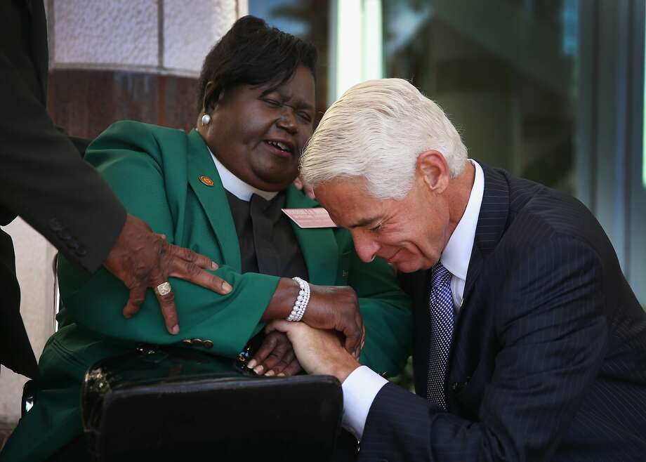 WEST PALM BEACH, FL - APRIL 14: The Reverand Edrena H Brown prays with former Florida Republican Governor Charlie Crist, who is currently the leading Democrat trying to unseat incumbent Republican Gov. Rick Scott, as he arrives to speak during the Forum Club of the Palm Beaches at the Cohen Pavilion at the Kravis Center on April 14, 2014 in West Palm Beach, Florida.  The former governor is showing a slight edge in the polls over Rick Scott as the campaign starts to heat up for the 2014 Florida gubernatorial election that will take place on November 4, 2014.  (Photo by Joe Raedle/Getty Images) Photo: Joe Raedle, Getty Images