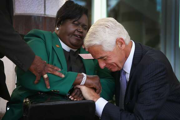 WEST PALM BEACH, FL - APRIL 14: The Reverand Edrena H Brown prays with former Florida Republican Governor Charlie Crist, who is currently the leading Democrat trying to unseat incumbent Republican Gov. Rick Scott, as he arrives to speak during the Forum Club of the Palm Beaches at the Cohen Pavilion at the Kravis Center on April 14, 2014 in West Palm Beach, Florida.  The former governor is showing a slight edge in the polls over Rick Scott as the campaign starts to heat up for the 2014 Florida gubernatorial election that will take place on November 4, 2014.  (Photo by Joe Raedle/Getty Images)