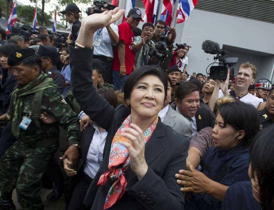Thai Prime Minister Yingluck Shinawatra waves to her supporters in Bangkok, Thailand Wednesday, May 7, 2014. Yingluck was ordered by a court to step down Wednesday in a divisive ruling that handed a victory to anti-government protesters who have staged six months of street protests - but does little to resolve the country's political crisis. (AP Photo/Sakchai Lalit) Photo: Sakchai Lalit, Associated Press