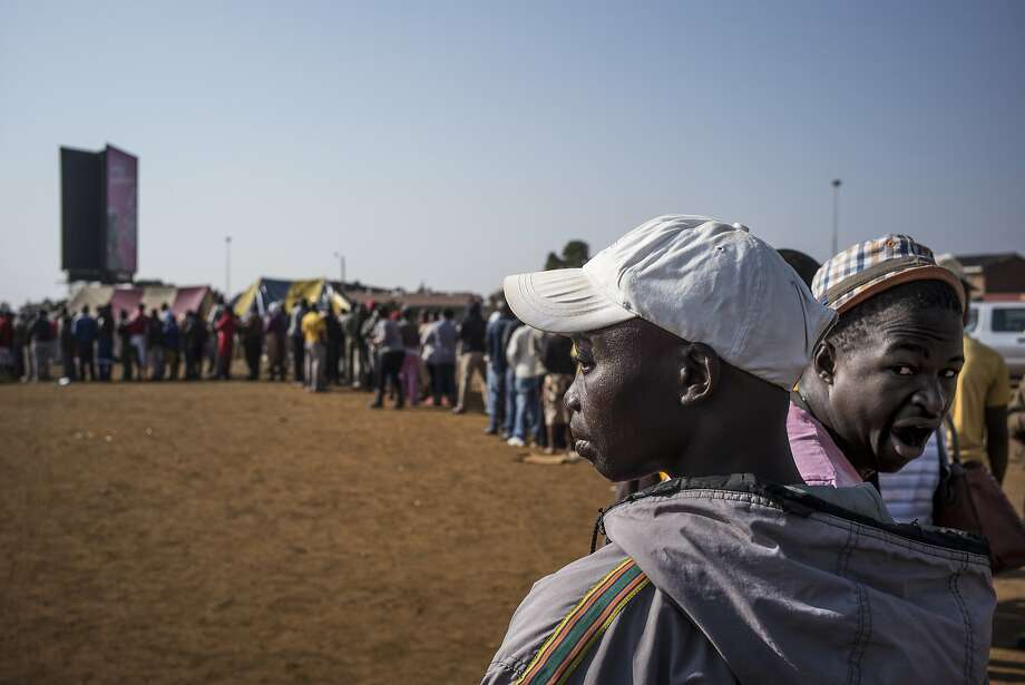 The democratic process in slow motion:South African voters wait in a long queue to vote at a polling station in the restive 