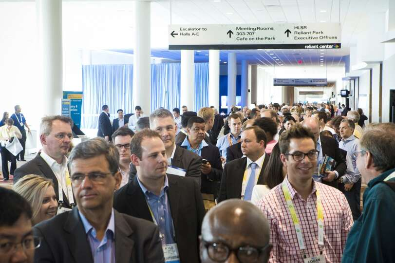 2014 Offshore Technology Conference visitors gather to attend the BP Energy Outlook session at the N