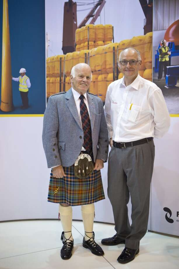 Balmoral Group Chairman and Managing Director Dr. James S. Milne, left, has been attending OTC for the past 40 years. Balmoral Group Public Relations Manager Steve Gibb, right, buys cowboy boots for his wife and cowboy shirts for himself whenever he attends OTC. Wednesday, May 7, 2014, in Houston. ( Marie D. De Jesus / Houston Chronicle ) Photo: Houston Chronicle
