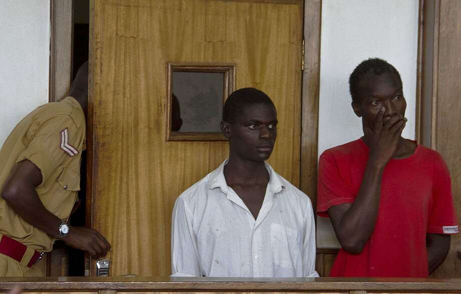 Two Ugandan men, Kim Mukisa (R) and Jackson Mukasa (L) appear before the Uganda Chief Magistrates Court in Kampala, charged on May 7, 2014 of unnatural offences. The couple, if found guilty, would be the first in the East African nation to go on trial since President Yoweri Museveni signed the anti-gay bill into law in February that has seen other cases end in dismissal for want of prosecution or have remained pending. AFP PHOTO/ ISAAC KASAMANIISAAC KASAMANI/AFP/Getty Images Photo: Isaac Kasamani, AFP/Getty Images