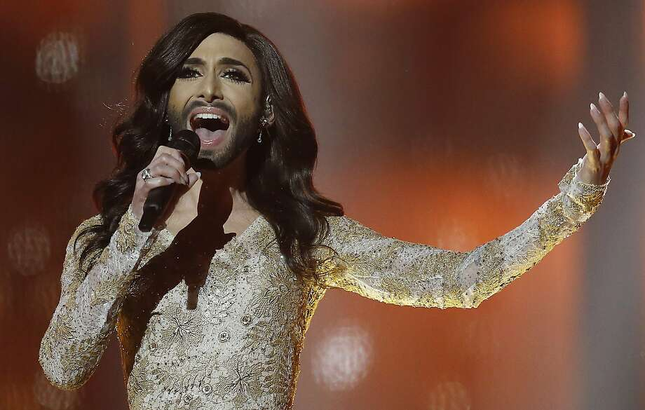 "The bearded diva: Singer Conchita Wurst, representing Austria, performs ""Rise Like a Phoenix"" during a rehearsal for the second semifinal of the Eurovision Song Contest in the B&W Halls in Copenhagen. Wurst is also known by her birth name, Thomas Neuwirth. Photo: Frank Augstein, Associated Press"
