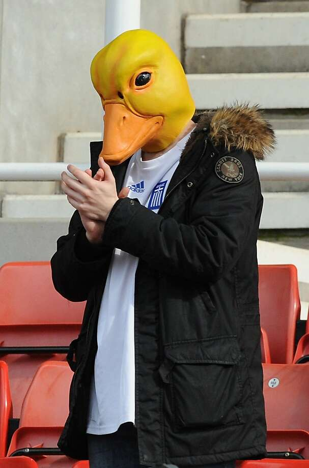 If it walks like a duck and claps like a duck, then it must be some guy in a duck costume at the Fulham-Stoke City English Premier League football match in Stoke on Trent. Photo: Rui Vieira, Associated Press