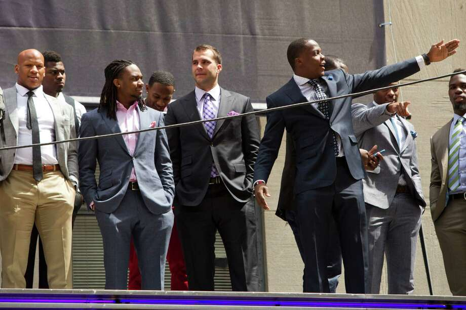 NFL Draft prospects pose for photos atop the Radio City Music Hall marquee Wednesday, May 7, 2014, in New York. Photo: Brett Coomer, Houston Chronicle / © 2014 Houston Chronicle