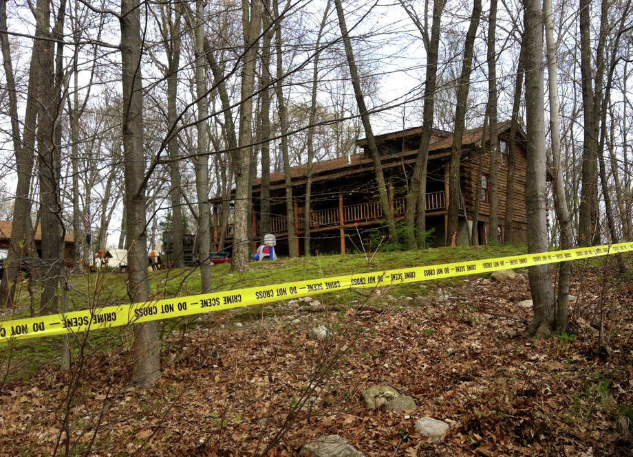 Thecrime scene at 55 Sioux Drive in Oxford, Conn. where Lori Gellatly was killed in a double shooting on Wednesday, May 7, 2014. Scott Gellaty is accused of killing of his estranged wife, Lori Gellatly, and shooting her mother, Merry Jackson. Photo: Jacqueline Smith / Connecticut Post contributed