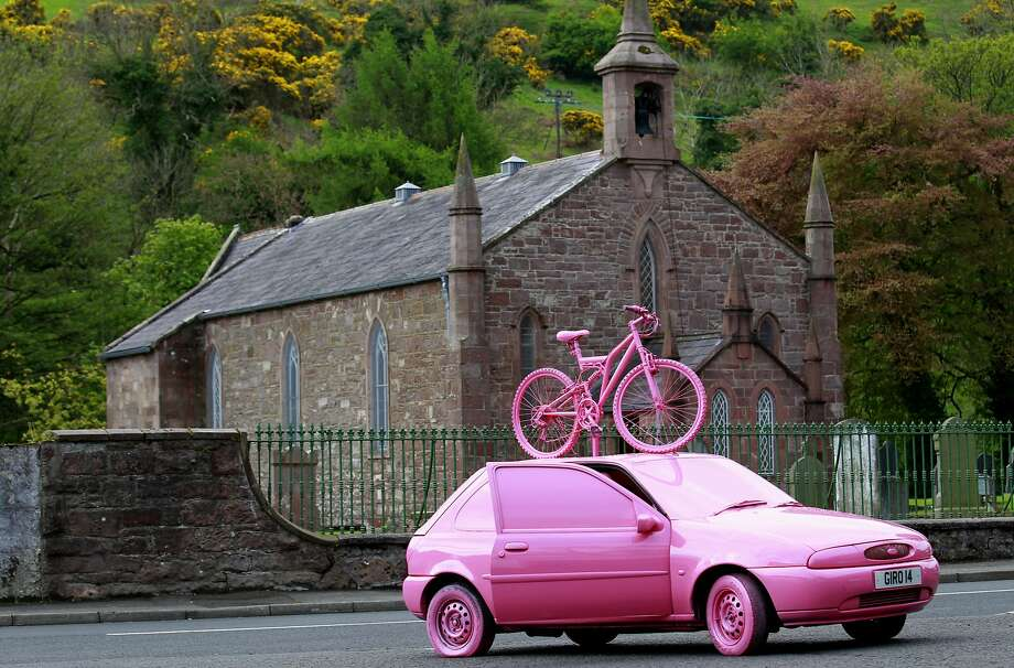 Pepto pink in the Emerald Isle: A car promotes the Giro d'Italia in the village of 