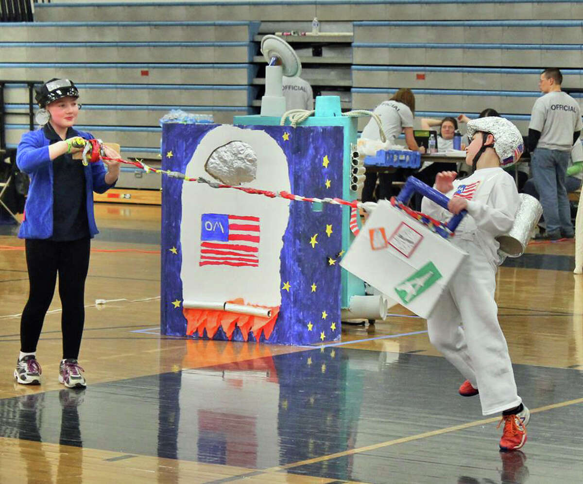 Ella Cognetti and Connor Tasik of Stillmeadow Elementary School perform a challenge during the Connecticut Odyssey of the Mind state finals in Bristol.