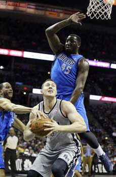San Antonio Spurs' Aron Baynes looks for room around Dallas Mavericks' Devin Harris and DeJuan Blair during first half action Sunday March 2, 2014 at the AT&T Center. Photo: Edward A. Ornelas, San Antonio Express-News