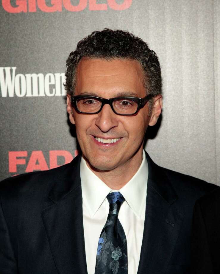 "Actor and director John Turturro attends a screening of ""Fading Gigolo"" sponsored by the Cinema Society and Women's Health magazine on Friday, April 11, 2014, in New York. (Photo by Andy Kropa/Invision/AP) ORG XMIT: NYAK107 Photo: Andy Kropa / Invision"