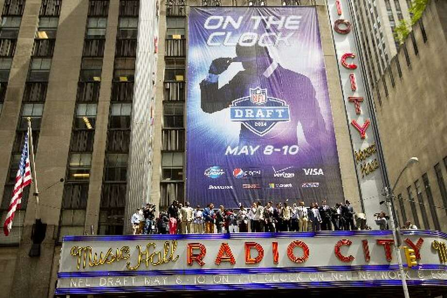 NFL draft prospects pose for photos atop the Radio City Music Hall marquee on Wednesday in New York Photo: Brett Coomer, Houston Chronicle