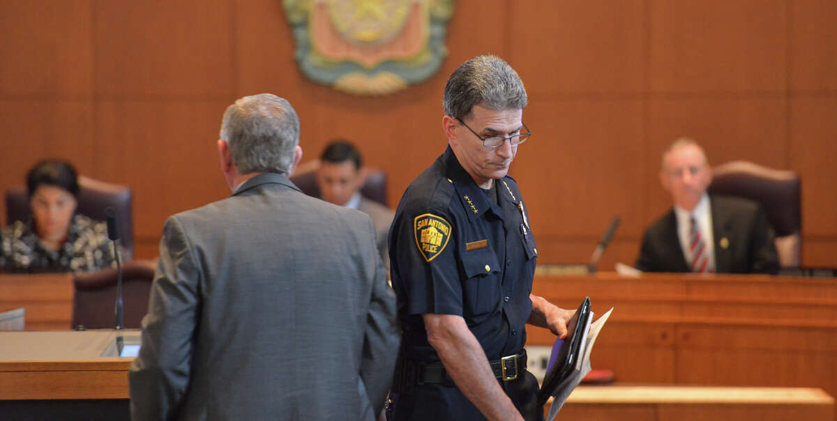 San Antonio Police Chief William McMannis finishes his brief remarks as Steve Baum prepares to go into detail during Wednesday's City Council Public Safety Committee meeting regarding taxi regulations and other transportation forms such as Lyft. Behind them are council members Rebecc Viagran, Chris Medina and Mike Gallagher.
