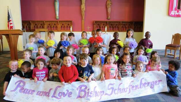 The Pre-K and Nursery school students at All Saints Catholic Academy send their best to Bishop Edward Scharfenberger when the school community gathered for Mass recently. (Karen Reilly)