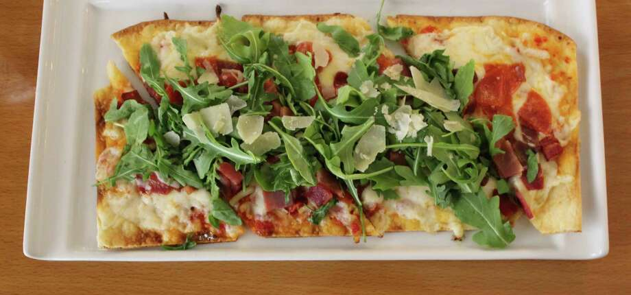The Napoli pizza at Market on Houston was the favorite dish during a recent lunch. Photo: Jennifer McInnis / San Antonio Express-News