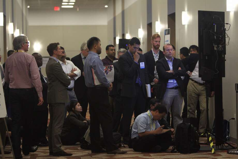Overflow moves into the hallway where they listen to Kathleen Eisbrenner deliver her remarks in the Floating LNG panel during the 2014 Offshore Technology Conference at NRG on May 7, 2014 in Houston. ( Mayra Beltran / Houston Chronicle )