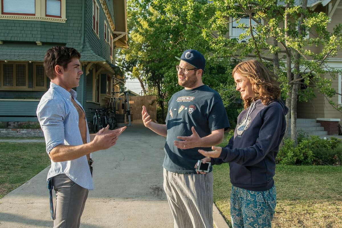 Teddy Sanders (ZAC EFRON) has a chat with neighbors Mac (SETH ROGEN) and Kelly Radner (ROSE BYRNE) in