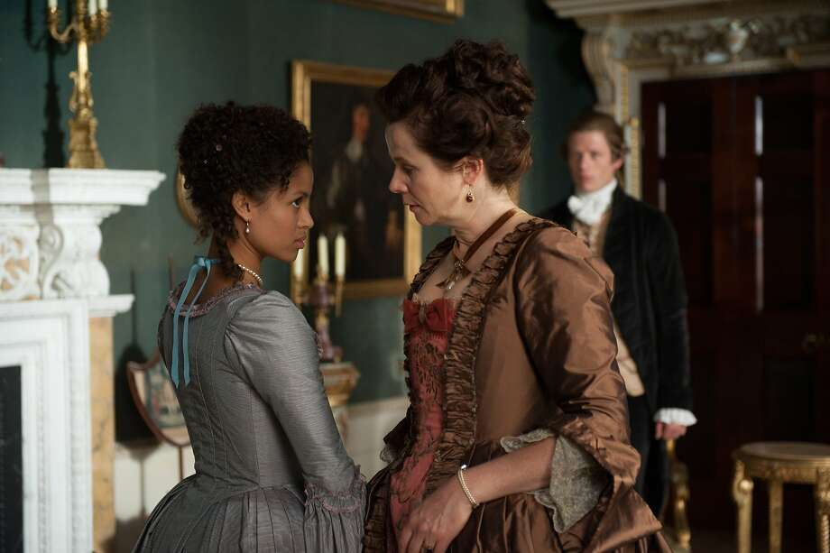 "Belle (Gugu Mbatha-Raw, left) grows up under the guiding hand of her aunt, Lady Mansfield (Emily Watson) in ""Belle."" Photo: David Appleby, Fox Searchlight"