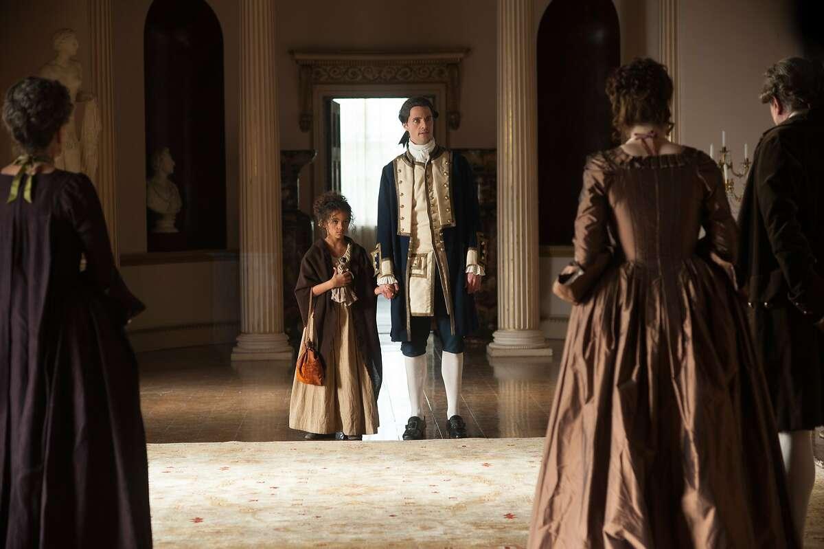 """Lauren Julien-Box, left, and Matthew Goode appear in a scene in, """"Belle."""""""