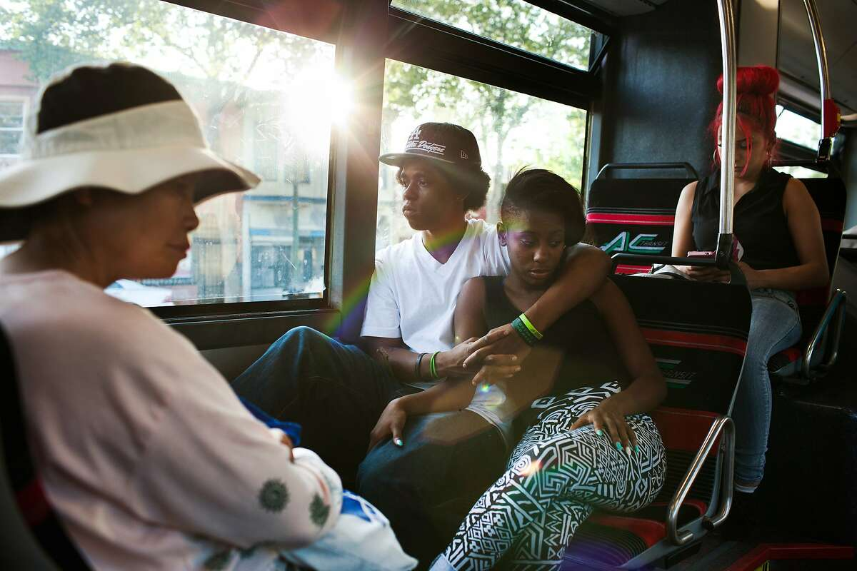 Javontae Roberts, 18, center left, and Lyric Stafford, 17, center right, ride the AC Transit 1R bus line toward Oakland, Calif. on Thursday, May 1, 2014. The 1R, which stands for rapid, is the predecessor to the bus rapid transit system that is slated to be built along International Boulevard. The BRT system will run more like a subway and will have dedicated lanes or stations. The new system has stalled due to public resistance to taking away a lane or two of traffic and eliminating parking.