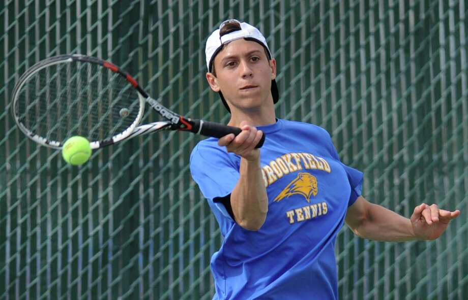 Brookfield's Tyler Goldstein returns the ball during the high school boys tennis match between Brookfield and New Fairfield at Brookfield High School in Brookfield, Conn. Wednesday, May 7, 2014. Photo: Tyler Sizemore / The News-Times