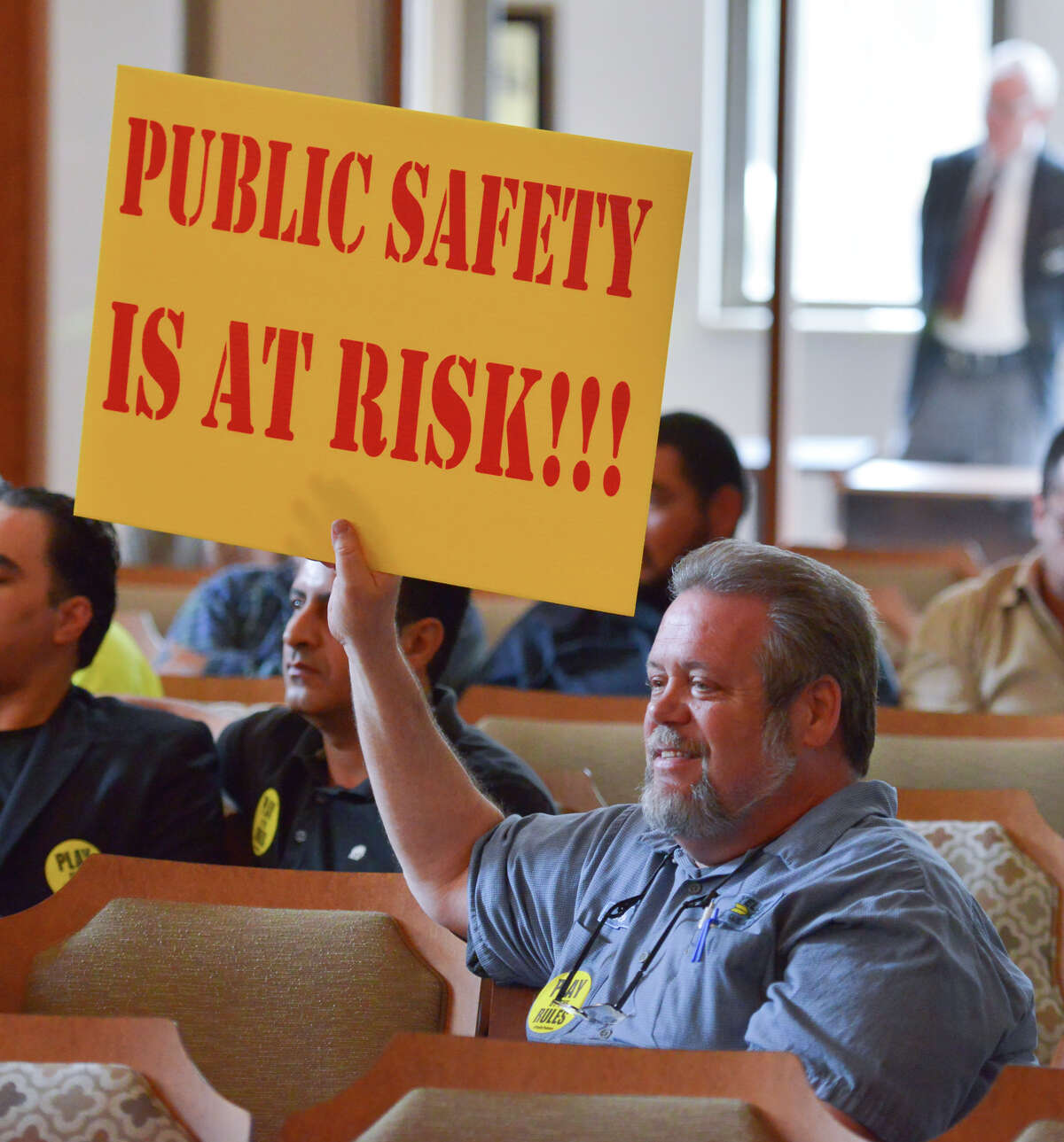 Steve Constantino, the service manager for Yellow Cab, expresses his opinion on the rideshare debate prior to the start of a City Council Public Safety Committee meeting.