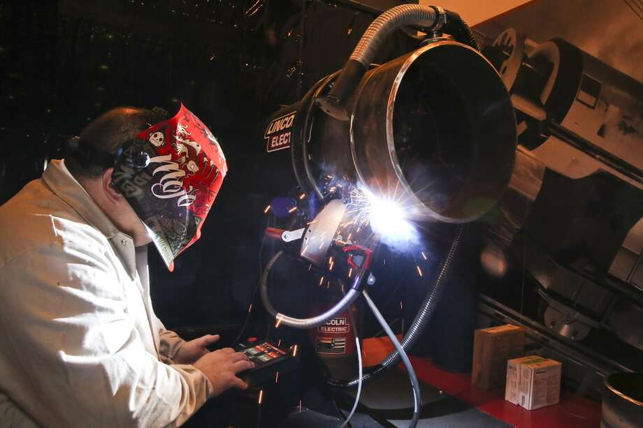 David Genske Jr. a pipe welding specialist with Lincoln Electric uses a M-85 Orbital to weld an 18 inch pipe on day three of OTC on May 7, 2014 inside the NRG Center in Houston, TX. (Photo: Thomas B. Shea/For the Chronicle) Photo: Thomas B. Shea, For The Chronicle