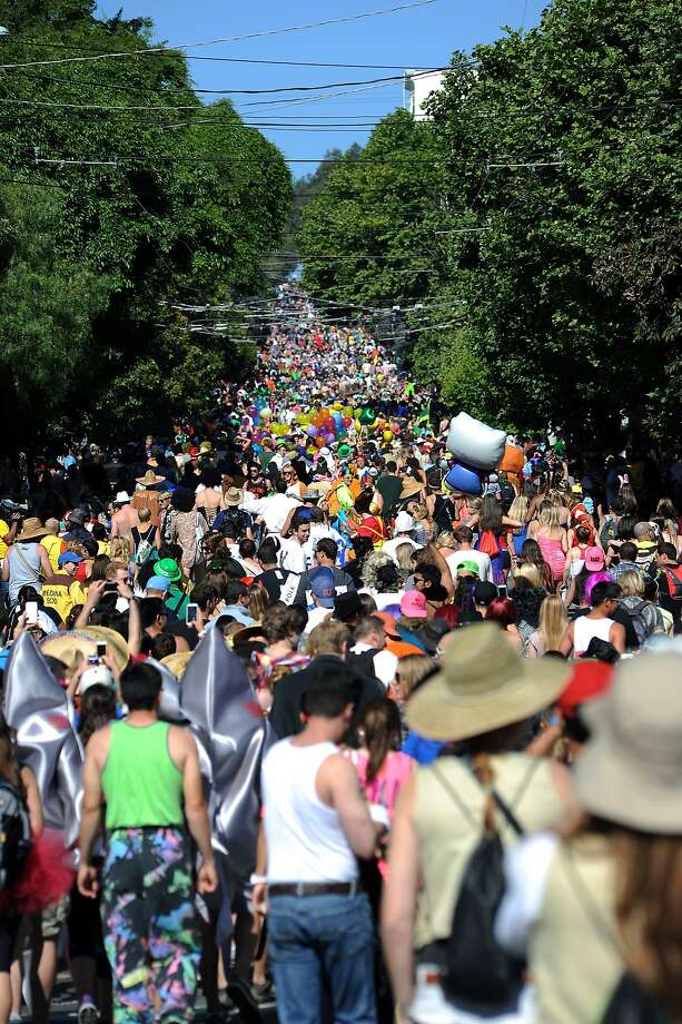 Runners head up Hayes Street Hill during the 2013 Bay to Breakers race. The top of the hill offers the best view during the race, and the Great Highway has the best view at the end. Photo: Michael Short, Special To The Chronicle
