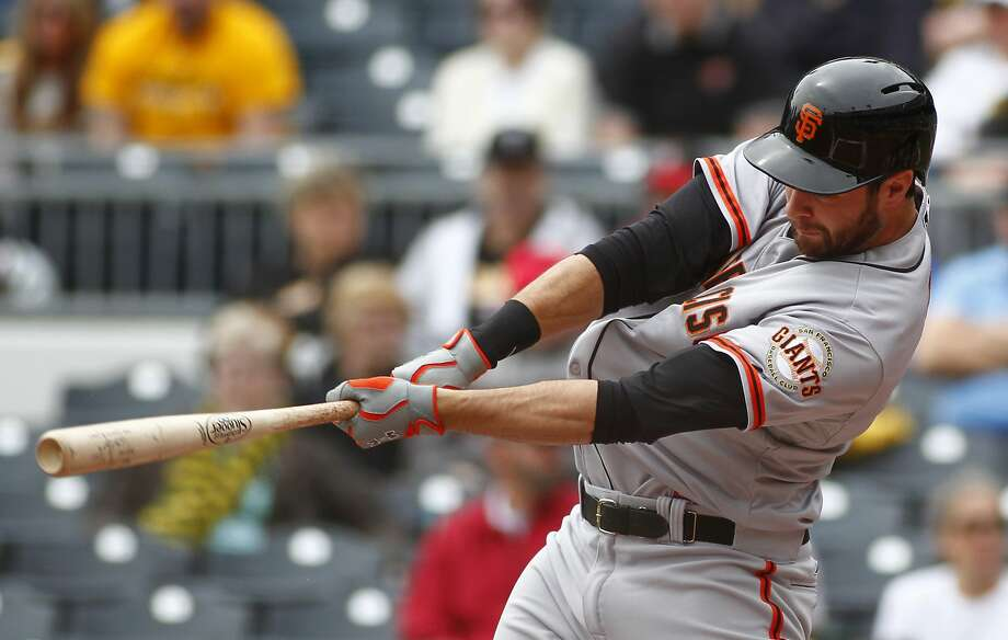 Brandon Belt, who later had a two-run double, hits a first-inning home run. Photo: Justin K. Aller, Getty Images