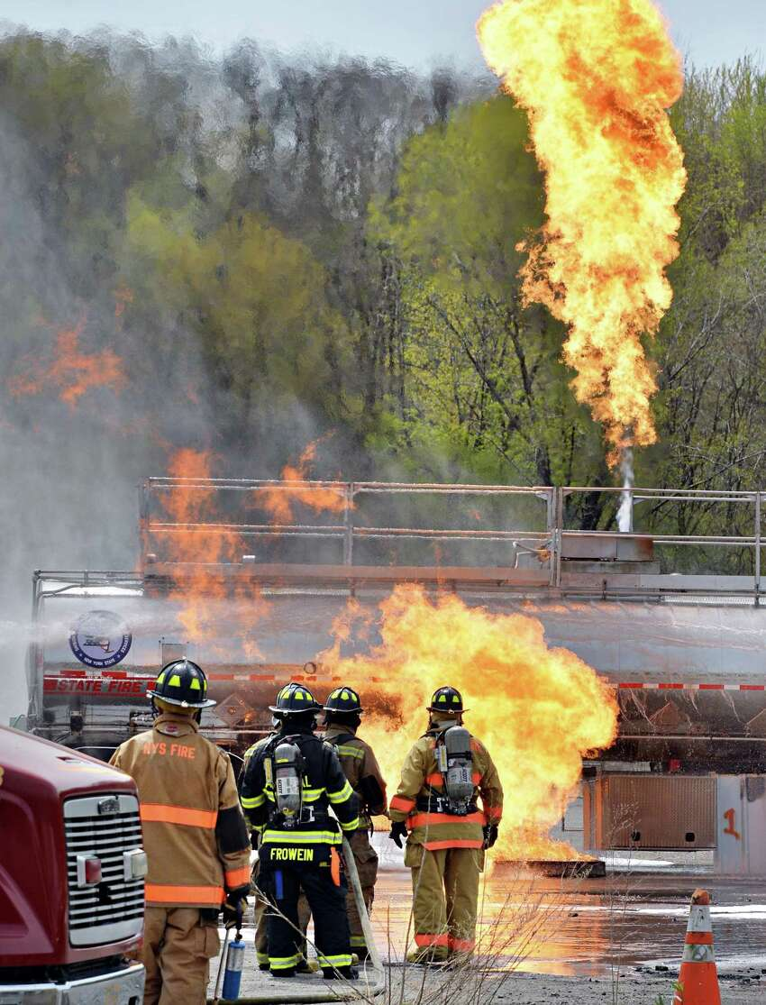 Firefighters at a live fire training drill on best practices for the suppression of ignitable liquids such as crude oil in the event of a flammable liquid emergency at the Port of Albany Wednesday May 7, 2014, in Albany, NY. (John Carl D'Annibale / Times Union)