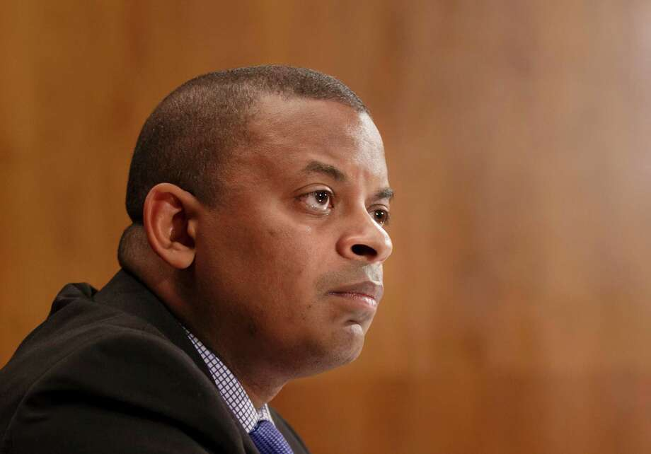 """FILE - This March 13, 2014 file photo shows  Transportation Secretary Anthony Foxx on Capitol Hill in Washington. The Transportation Department issued an emergency order on May 7 requiring that railroads inform state emergency management officials before moving large shipments of crude oil through their states, and urged railroads not to use older model tanks cars that are easily ruptured in accidents, even at slow speeds. """"All options are on the table when it comes to improving the safe transportation of crude oil, and today?s actions, the latest in a series that make up an expansive strategy, will ensure that communities are more informed and that companies are using the strongest possible tank cars,"""" Foxx said in a statement. (AP Photo/J. Scott Applewhite, File) Photo: J. Scott Applewhite, STF / AP"""